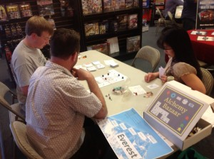 Alchemy Bazaar in action at Unpub Mini. Note the game board for my super-rough game Everest in the foreground.
